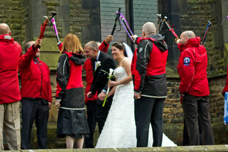Rescuers form a guard of honour as Calder Valley Search and Rescue Team leader Alex Day and member Rachel Smith leave Todmorden Unitarian Church after their wedding